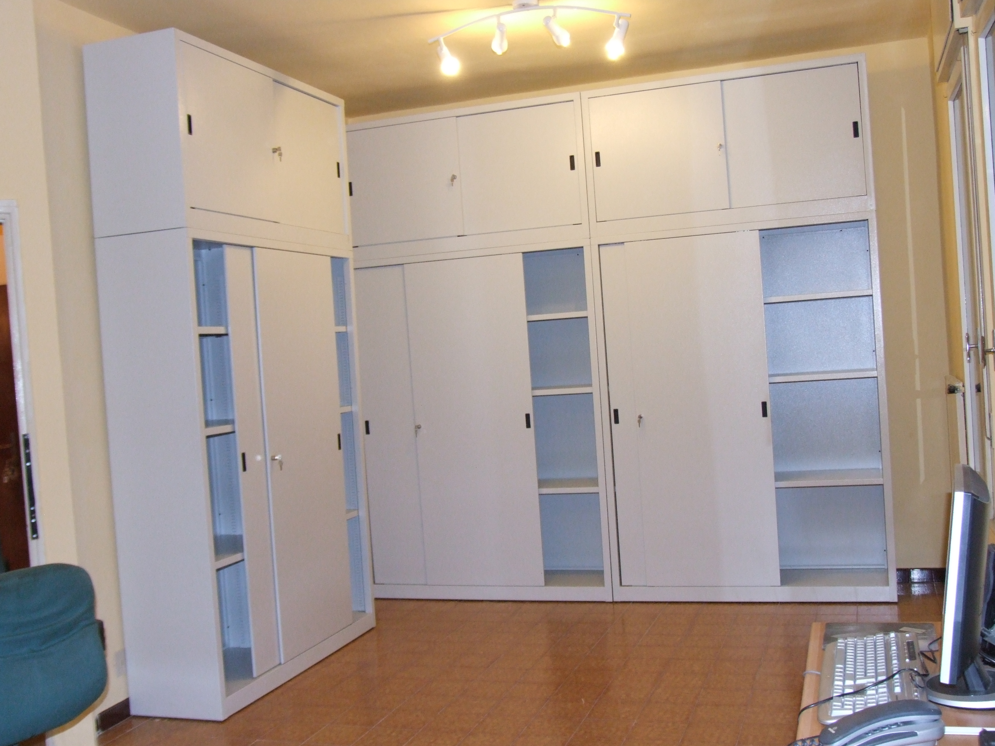 Votivo Sacred Furnishings: Customized cupboard for parish archives.